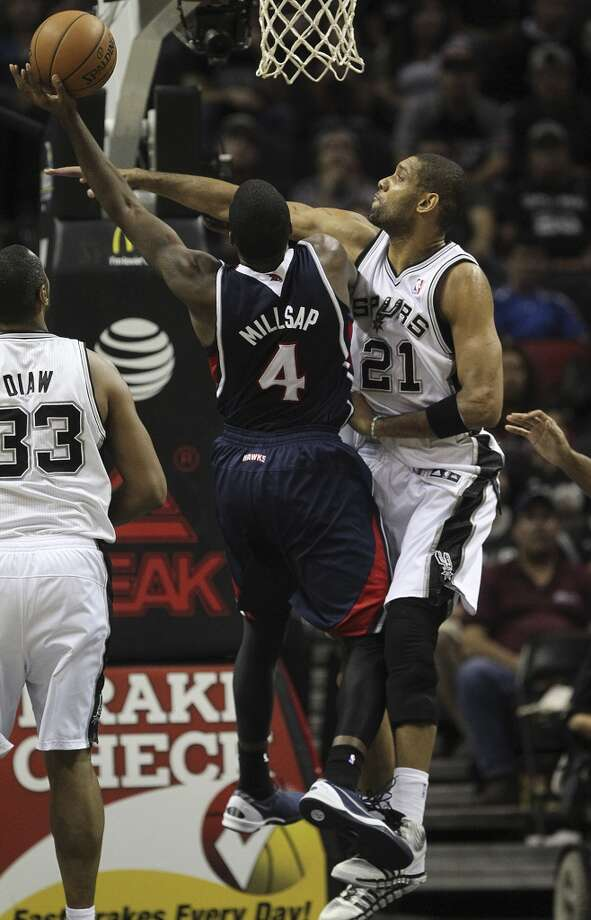 San Antonio Spurs' Tim Duncan puts pressure on Atlanta Hawks' Paul Millsap during the second half at the AT&T Center, Monday, Dec. 2, 2013. The Spurs won 102-100. Photo: Jerry Lara, San Antonio Express-News