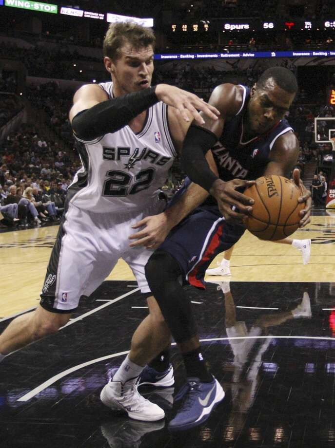 San Antonio Spurs' Tiago Splitter fights for a rebound against Atlanta Hawks' Paul Millsap during the second half at the AT&T Center, Monday, Dec. 2, 2013. The Spurs won 102-100. Photo: Jerry Lara, San Antonio Express-News