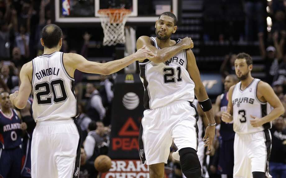 San Antonio Spurs' Tim Duncan (21) celebrates with teammate Manu Ginobili (20) after he scored with less than a second remaining in the second half of an NBA basketball game, Monday,  Dec. 2, 2013, in San Antonio. San Antonio won 102-100. Photo: Eric Gay, Associated Press