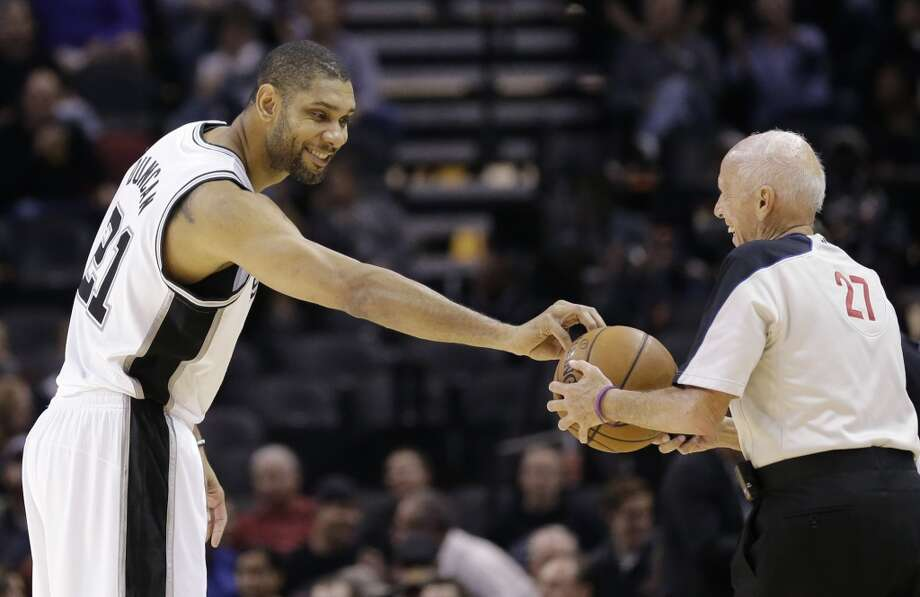 San Antonio Spurs' Tim Duncan, left, jokes with official Dick Bavetta, right, prior to an NBA basketball game against the Atlanta Hawks, Monday,  Dec. 2, 2013, in San Antonio. Photo: Eric Gay, Associated Press
