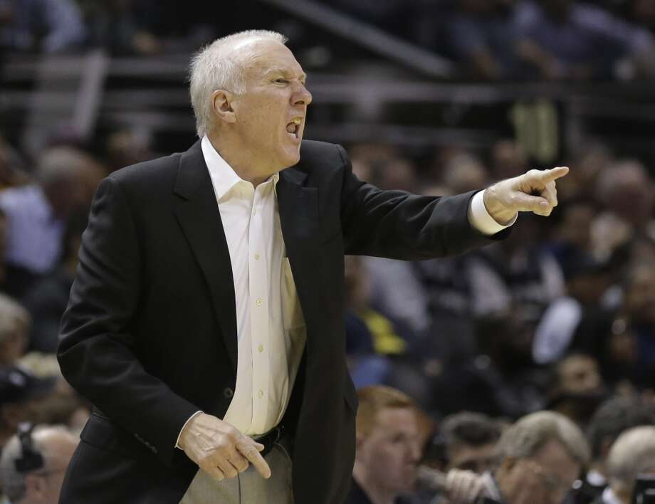 San Antonio Spurs coach Gregg Popovich calls to his players during the first half of an NBA basketball game against the Atlanta Hawks, Monday,  Dec. 2, 2013, in San Antonio. Photo: Eric Gay, Associated Press