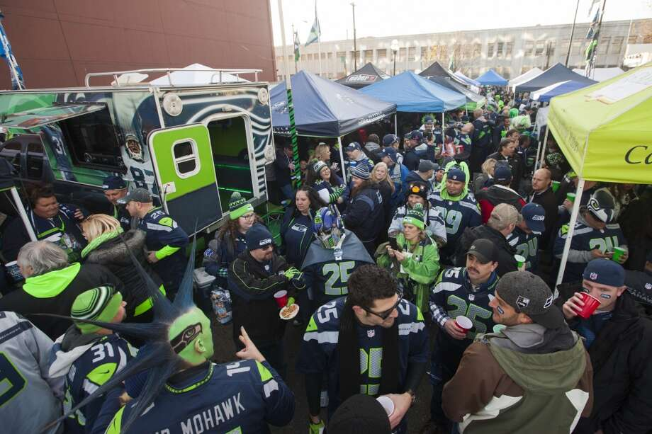 Fans tailgate before the start of the Seahawks and Saints game Monday, Dec. 2, 2013, at CenturyLink Field in Seattle. Photo: MARK MALIJAN, SEATTLEPI.COM