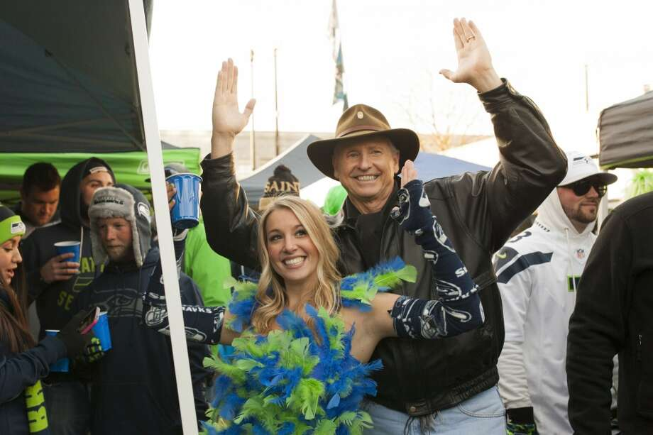 Lance Easley, right, takes a photo with Kiely D'Intino during tailgating festivities before the start of the Seahawks and Saints game Monday, Dec. 2, 2013, at CenturyLink Field in Seattle. Easley is also known as the replacement official that called a controversial touchdown for the Seahawks against Green Bay. Photo: MARK MALIJAN, SEATTLEPI.COM