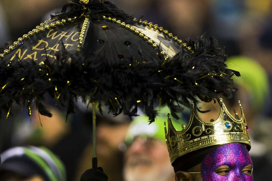 Saints fans celebrate in the audience during the second half of game Monday, Dec. 2, 2013, at CenturyLink Field in Seattle. The Seahawks beat the Saints 34-7. Photo: JORDAN STEAD, SEATTLEPI.COM