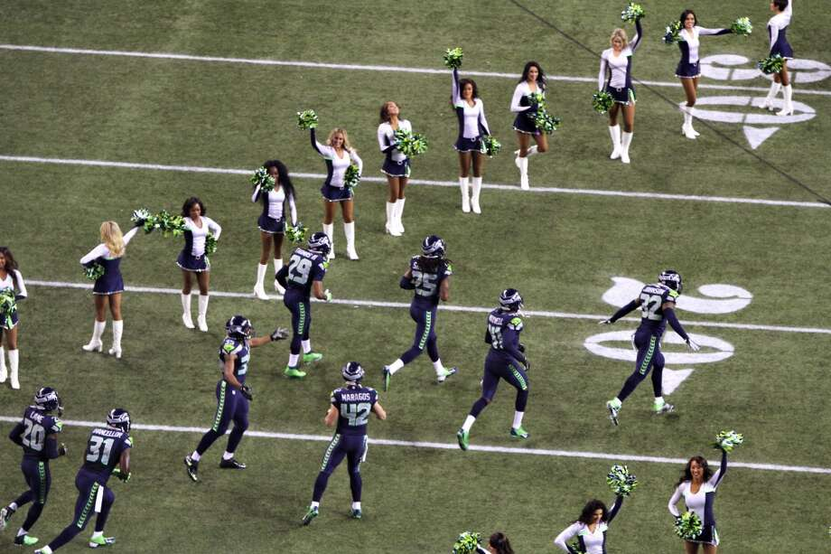 Seahawks enter the field to take on the Saints before the start of Monday night's game at CenturyLink Field in Seattle. Photo: MARK MALIJAN, SEATTLEPI.COM