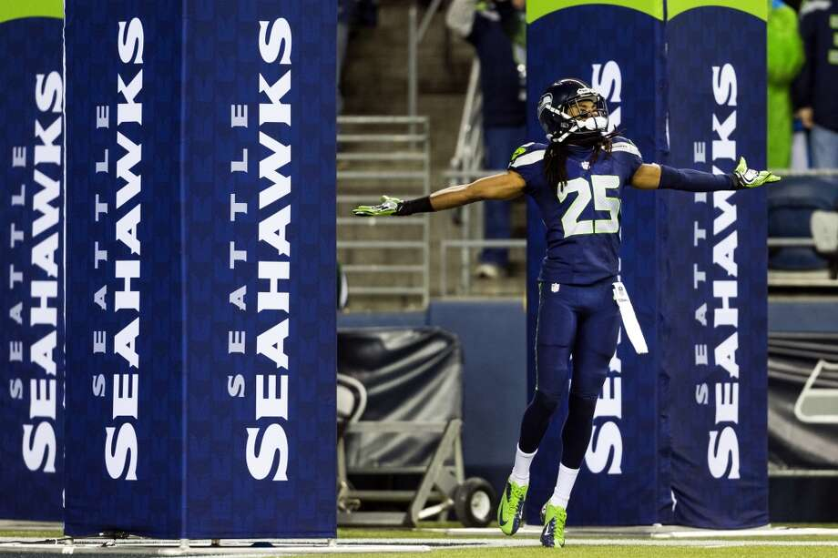 Richard Sherman enters the field with flair before a game against the New Orleans Saints Monday, Dec. 2, 2013, at CenturyLink Field in Seattle. The Seahawks led the Saints 27-7 at the end of the first half. Photo: JORDAN STEAD, SEATTLEPI.COM