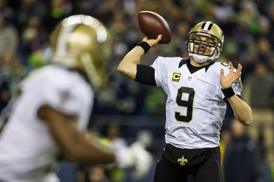 New Orleans Saints quarterback Drew Brees, right, prepares to pass to a teammate during the first quarter of a game against the Seahawks Monday, Dec. 2, 2013, at CenturyLink Field in Seattle. The Seahawks led the Saints 27-7 at the end of the first half. Photo: JORDAN STEAD, SEATTLEPI.COM