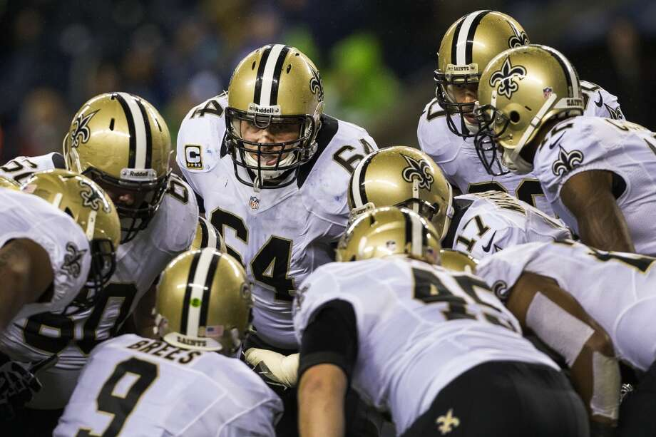 The Saints discuss their next play during the first half of game against the Seahawks Monday, Dec. 2, 2013, at CenturyLink Field in Seattle. The Seahawks led the Saints 27-7 at the end of the first half. Photo: JORDAN STEAD, SEATTLEPI.COM