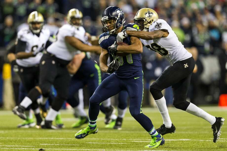 Golden Tate, center, shrugs away a tackle on his way downfield during the first half of game Monday, Dec. 2, 2013, at CenturyLink Field in Seattle. The Seahawks led the Saints 27-7 at the end of the first half. Photo: JORDAN STEAD, SEATTLEPI.COM