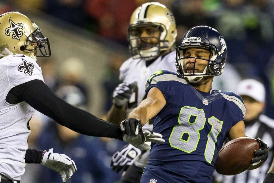 Golden Tate, right, deflects a push from a New Orleans Saints player during the first half of game Monday, Dec. 2, 2013, at CenturyLink Field in Seattle. The Seahawks led the Saints 27-7 at the end of the first half. Photo: JORDAN STEAD, SEATTLEPI.COM