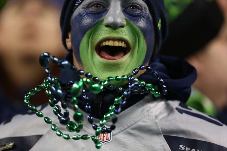 A Seahawks fan cheers for his team as they play the Saints during an NFL game on Monday, Dec. 2, 2013, at CenturyLink Field in Seattle. Photo: JOSHUA TRUJILLO, SEATTLEPI.COM