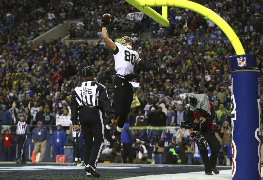 Saints player Jimmy Graham slams dunks the ball over the field goal post after he scored a touchdown in the second quarter of an NFL game on Monday, Dec. 2, 2013, at CenturyLink Field in Seattle. Photo: JOSHUA TRUJILLO, SEATTLEPI.COM