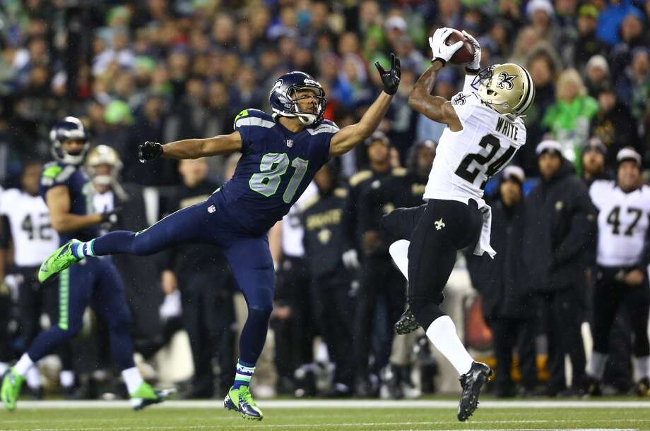 Seahawks player Golden Tate breaks up a pass intended for Corey White (24) Saints during an NFL game on Monday, Dec. 2, 2013, at CenturyLink Field in Seattle. Photo: JOSHUA TRUJILLO, SEATTLEPI.COM
