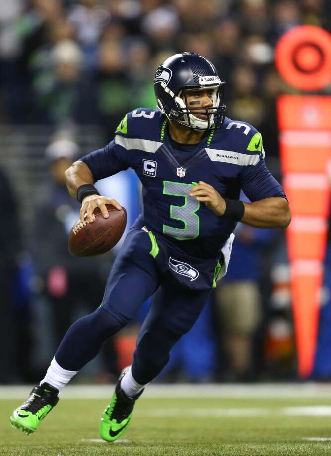 Seahawks quarterback Russell Wilson prepares to throw against the Saints during an NFL game on Monday, Dec. 2, 2013, at CenturyLink Field in Seattle. Photo: JOSHUA TRUJILLO, SEATTLEPI.COM