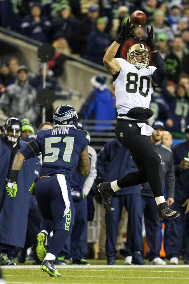 Saints' player Jimmy Graham, right, leaps for a mid-field catch during the first half of game against the Seahawks Monday, Dec. 2, 2013, at CenturyLink Field in Seattle. The Seahawks led the Saints 27-7 at the end of the first half. Photo: JORDAN STEAD, SEATTLEPI.COM