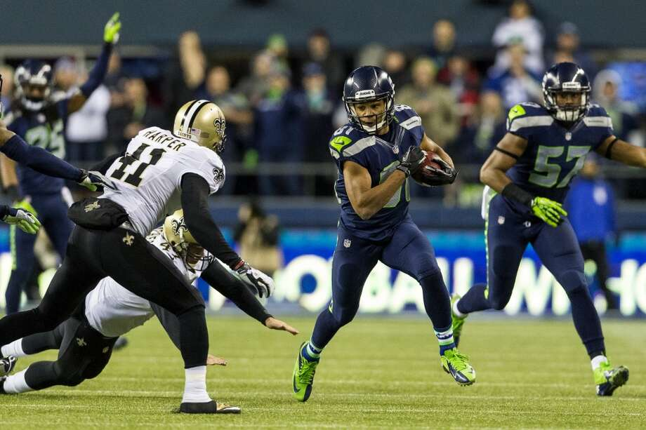 Seahawk Golden Tate, center, makes a run downfield during the first half of game Monday, Dec. 2, 2013, at CenturyLink Field in Seattle. The Seahawks led the Saints 27-7 at the end of the first half. Photo: JORDAN STEAD, SEATTLEPI.COM