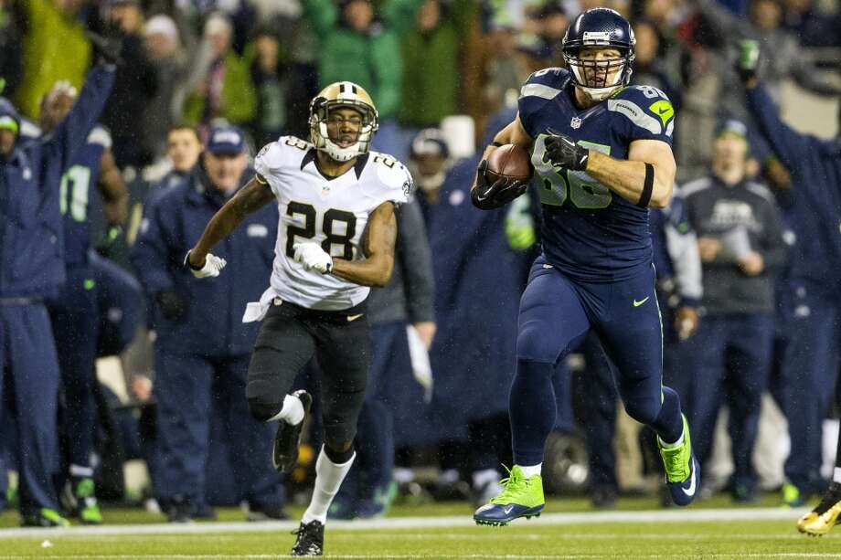 Seahawk Zach Miller, right, tears downfield for a touchdown against the Saints during the first half of game Monday, Dec. 2, 2013, at CenturyLink Field in Seattle. The Seahawks led the Saints 27-7 at the end of the first half. Photo: JORDAN STEAD, SEATTLEPI.COM