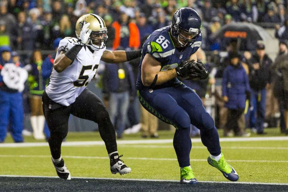 Seahawk Zach Miller, right, scores a touchdown against the Saints during the first half of game Monday, Dec. 2, 2013, at CenturyLink Field in Seattle. The Seahawks led the Saints 27-7 at the end of the first half. Photo: JORDAN STEAD, SEATTLEPI.COM