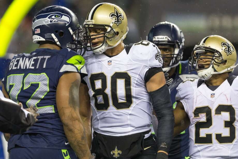 New Orleans Saints player Jimmy Graham, center left, taunts Seahawk Michael Bennett, left, after scoring a touchdown against the Seahawks during the first half of game Monday, Dec. 2, 2013, at CenturyLink Field in Seattle. The Seahawks led the Saints 27-7 at the end of the first half. Photo: JORDAN STEAD, SEATTLEPI.COM