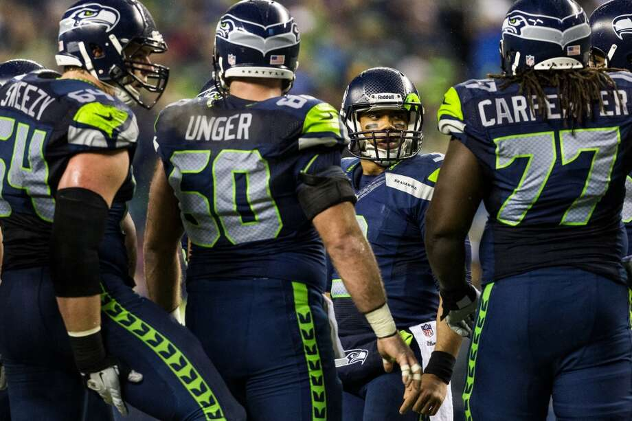 Seahawks' quarterback Russell Wilson, center right, is seen between teammates during the first half of game against the Saints Monday, Dec. 2, 2013, at CenturyLink Field in Seattle. The Seahawks led the Saints 27-7 at the end of the first half. Photo: JORDAN STEAD, SEATTLEPI.COM