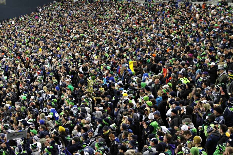 Fans cheer during the Seahawks and Saints game Monday, Dec. 2, 2013, at CenturyLink Field in Seattle. The Seahawks went on to win 34-7 against the Saints. Photo: MARK MALIJAN, SEATTLEPI.COM