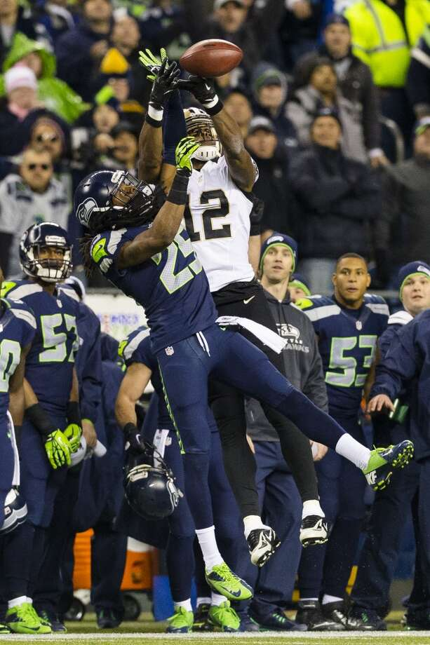 Richard Sherman, left, blocks a catch by Marques Colston, right, during the second half of game Monday, Dec. 2, 2013, at CenturyLink Field in Seattle. The Seahawks beat the Saints 34-7. Photo: JORDAN STEAD, SEATTLEPI.COM