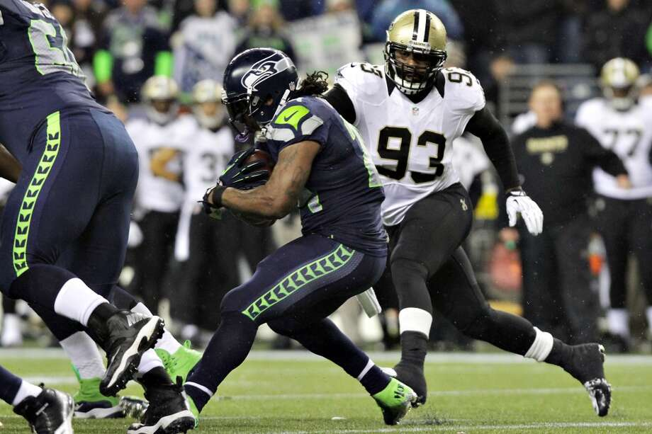 Seahawks Marshawn Lynch gets away from Saints Junior Galette in the second quarter of the game Monday, Dec. 2, 2013, at CenturyLink Field in Seattle. Photo: MARK MALIJAN, SEATTLEPI.COM