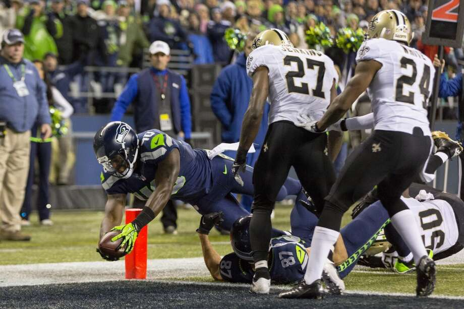 Off of an eight-yard pass from Russell Wilson, Seahawk Derrick Coleman, left, dives into the end zone to score a touchdown against the New Orleans Saints during the second half of game Monday, Dec. 2, 2013, at CenturyLink Field in Seattle. The Seahawks beat the Saints 34-7. Photo: JORDAN STEAD, SEATTLEPI.COM
