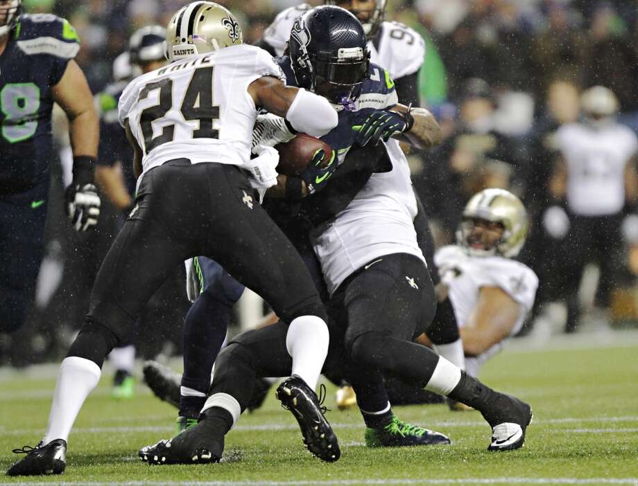 Seahawks Marshawn Lynch breaks away from the Saints defense during the second quarter of Monday's game Monday, Dec. 2, 2013, at CenturyLink Field in Seattle. Photo: MARK MALIJAN, SEATTLEPI.COM