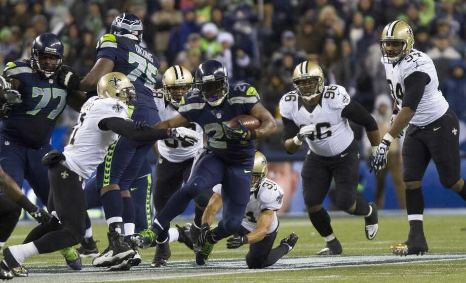Seahawks Marshawn Lynch is chased down by the Saints defense during the second quarter of the game Monday, Dec. 2, 2013, at CenturyLink Field in Seattle. Photo: MARK MALIJAN, SEATTLEPI.COM