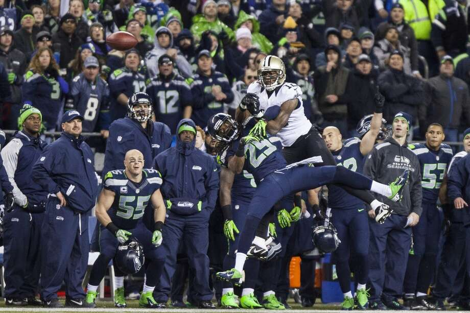 Seahawks Richard Sherman disrupts a pass intended for Saints Marques Colston during the third quarter of the game Monday, Dec. 2, 2013, at CenturyLink Field in Seattle. Photo: MARK MALIJAN, SEATTLEPI.COM