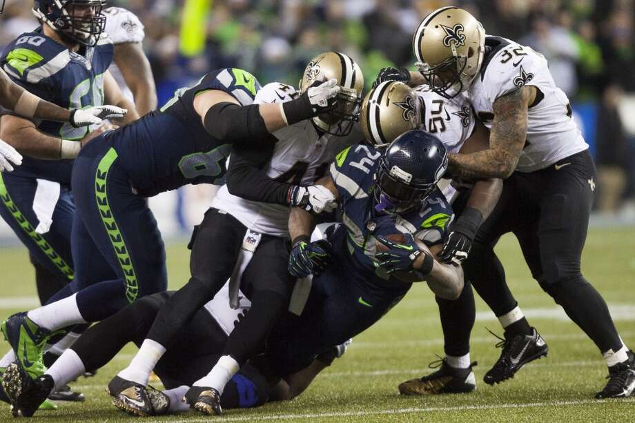 Seahawks Marshawn Lynch us taken down by the Saints defense during the third quarter of the game Monday, Dec. 2, 2013, at CenturyLink Field in Seattle. Photo: MARK MALIJAN, SEATTLEPI.COM