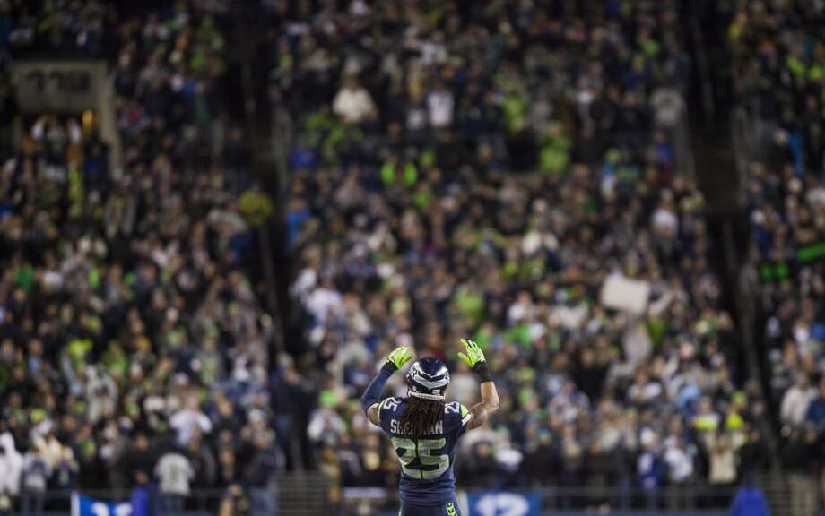 Seahawks Richard Sherman pumps up the crowd during the game Monday, Dec. 2, 2013, at CenturyLink Field in Seattle. Photo: MARK MALIJAN, SEATTLEPI.COM