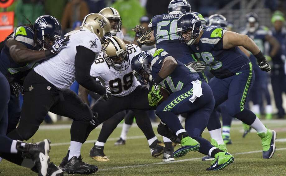 Seahawks Robert Turbin tries to break through the Saints defense in the fourth quarter of the game Monday, Dec. 2, 2013, at CenturyLink Field in Seattle. Photo: MARK MALIJAN, SEATTLEPI.COM
