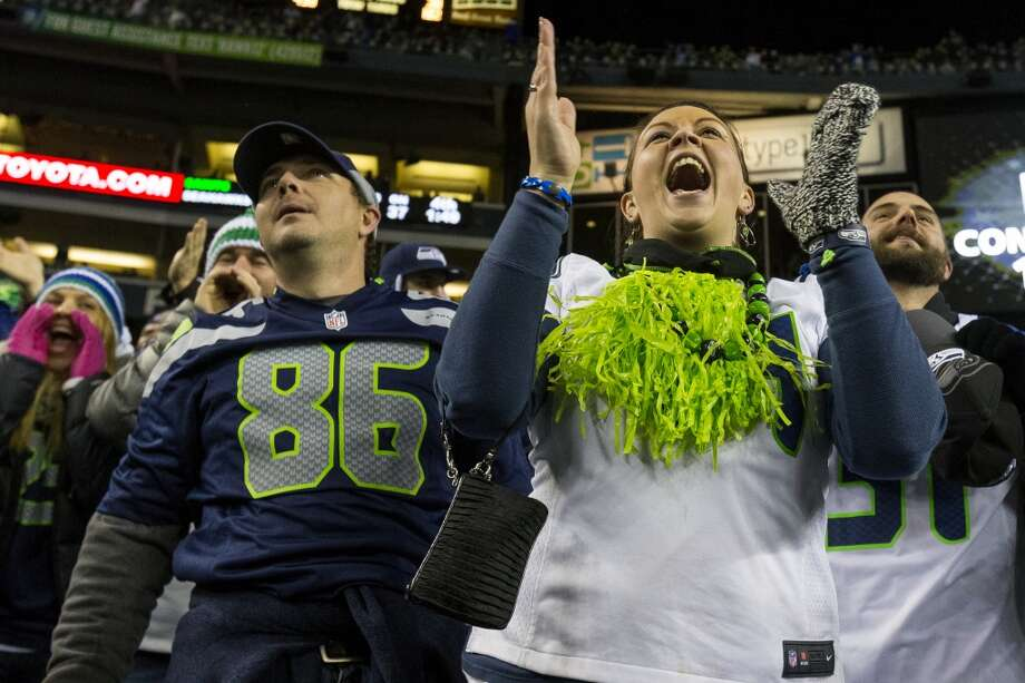 Seahawks fans celebrate the breaking of another Guinness Book of World Records' goal of 137.6 decibels during the second half of game Monday, Dec. 2, 2013, at CenturyLink Field in Seattle. The Seahawks beat the Saints 34-7. Photo: JORDAN STEAD, SEATTLEPI.COM