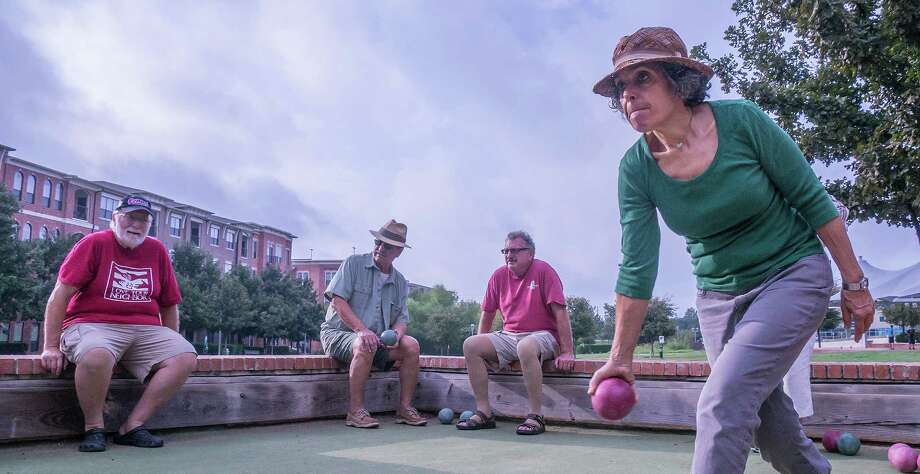 Susan Whyne of the Hill Country Bocce Club takes a shot during a game. Photo by Joshua Trudell/For the Express-News