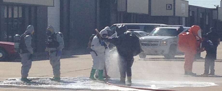Law enforcement officers in Stafford in September wearing hazardous material safety suits outside a business where police say so-called synthetic marijuana was being made and packaged for sale at smoke shops and convenience stores. Authorities were called in after five workers were overcome by fumes and staggered away for medical help.(Special for the Houston Chronicle)