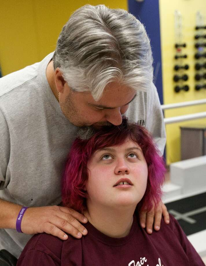 Emily Bauer, 17, suffered a series of strokes a year ago after she said she smoked synthetic marijuana.  The Cypress resident is undergoing physical rehabilitation at the Institute for Rehabilitation and Research outpatient facility at Memorial Hermann Northwest Hospital. (Cody Duty/ Houston Chronicle)