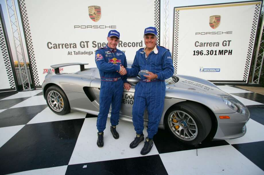 David Donohue (left) congratulates Jay Leno (right), who set three standing start speed records in the Porsche Carrera GT at Talladega Superspeedway. Porsche will donate the Carrera GT for an auction to benefit the victims of hurricane Katrina. Photo: HO, PRN