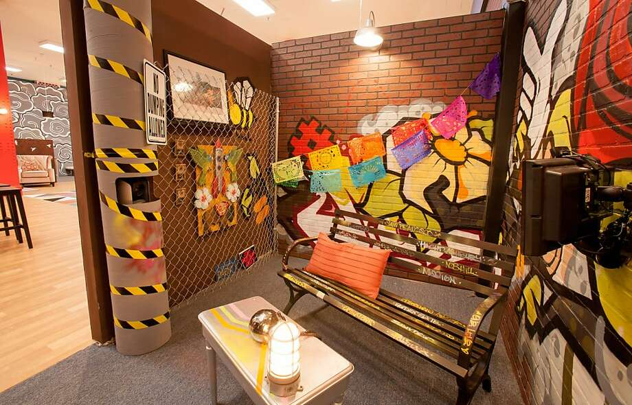 A graffiti-tagged bench in a room covered with Mission-style murals. Photo: Pete Yang/MTV
