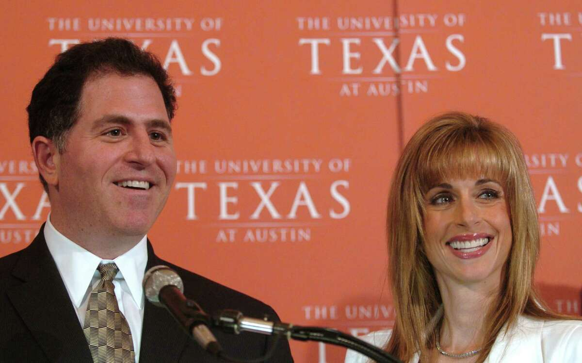 Michael Dell, CEO of Dell Inc., and his wife Susan are shown Monday, May 15 2006, in Austin, Texas, after they announce a gift of $50 million gift to the University of Texas for a pediatric research institute, a center for health living and a computer sciences building.