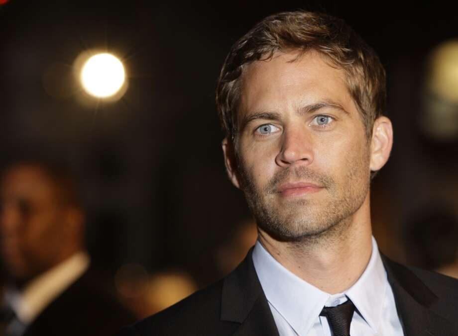 "Paul Walker, 1973-2013: The star of the ""Fast & Furious"" franchise died in an automobile crash while as passenger in his friend's 2005 Porsche Carrera GT near Los Angeles on November 30. Photo: Joel Ryan, ASSOCIATED PRESS"