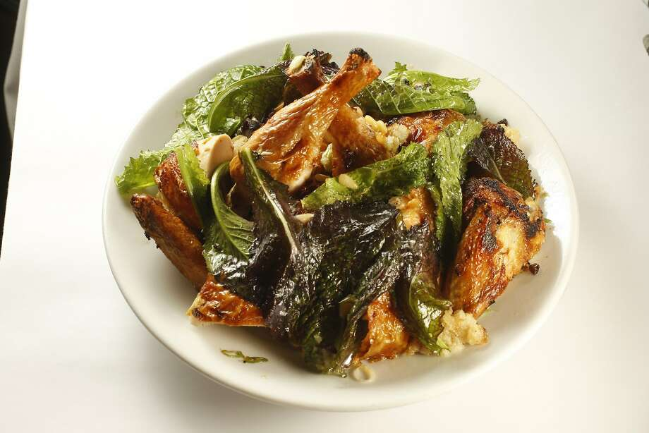 One of Zuni's most beloved dishes, the Zuni Roast Chicken With Bread Salad. Photo: Craig Lee, The Chronicle