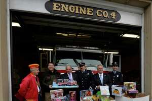 The Toys for Tots campaign kicked off by, from right, Tim Forbes, Marine Corp League, Pat Lurenz, assistant coordinator for the U. S. Marines,  Ed Manny, Rensselaer County Legislator, Jerry Vogt, president, Troy Firefighters Union, and Frank Razzano of the firefighters union in front of Engine 4 Tuesday morning, Dec. 3, 2013, in Troy, N.Y. (Skip Dickstein/Times Union)
