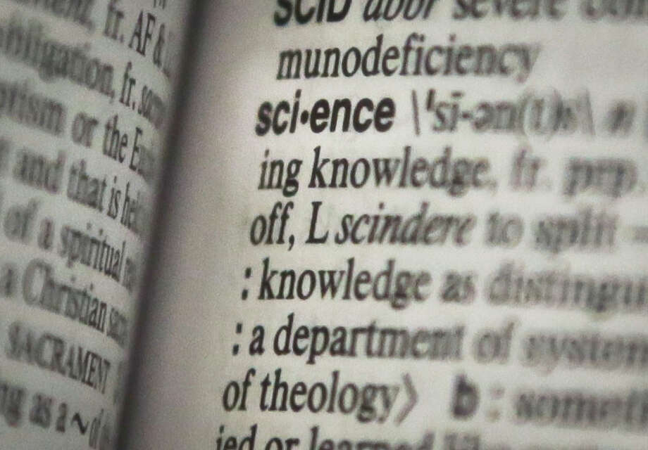 "This Monday, Dec. 2, 2013 photo shows the word ""science"" on a page of a Merriam-Webster dictionary, in New York. ""Science"" is the publisher's word of the year. (AP Photo/Bebeto Matthews) ORG XMIT: NYBM201 Photo: Bebeto Matthews / AP"
