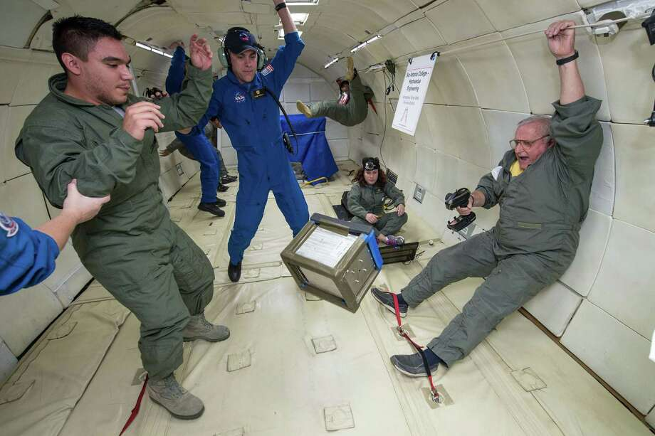 Dan Dimitriu, San Antonio College engineering coordinator, far right, and his students float in reduced gravity aboard a NASA aircraft Nov. 15 over the Gulf of Mexico. Two select teams of SAC engineering students conducted their own experiments in microgravity. Photo: Courtesy Photo / NASA