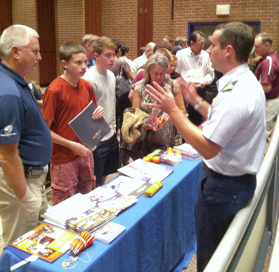 A representative from the U.S. Coast Guard Academy meets Cy-Fair parents and students during Military Academy Night Nov. 19. Photo: Provided By Cy-Fair Independent School District