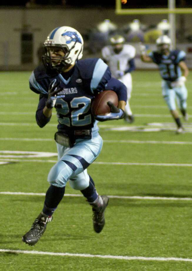 Johnson defensive back Elijah Lloyd returns an interception for a touchdown during the second quarter Friday against Laredo Alexander in Corpus Christi. Photo: Jason Mack / Laredo Morning Times