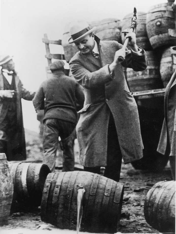 Federal policemen destroying a rum-runner's cargo in San Francisco during prohibition. Pickaxes are being used to pierce the barrels and let the rum run out. Photo: Library Of Congress, Getty Images / Archive Photos