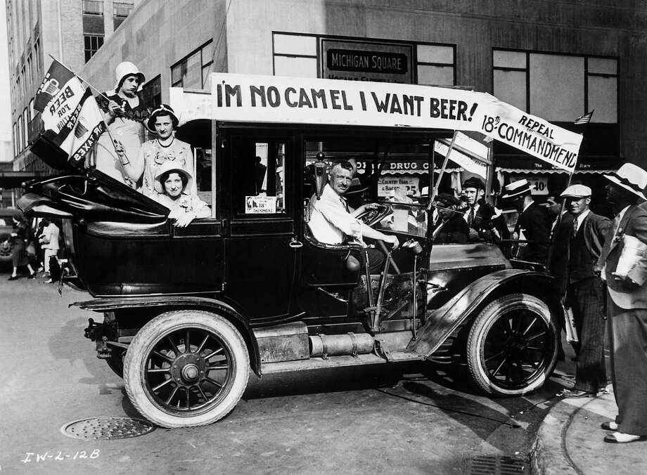 Prohibition protesters parade in a car emblazoned with signs and flags calling for the repeal of the 18th Amendment. One sign reads, 'I'M NO CAMEL I WANT BEER!' Photo: Archive Photos, Getty Images / Archive Photos